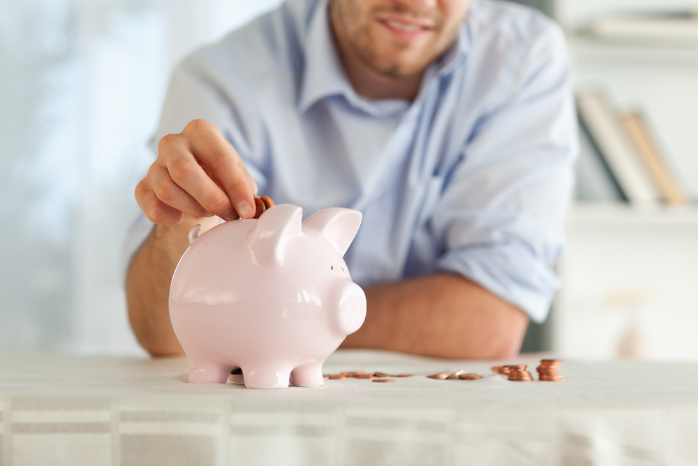 Small change being put into piggy bank