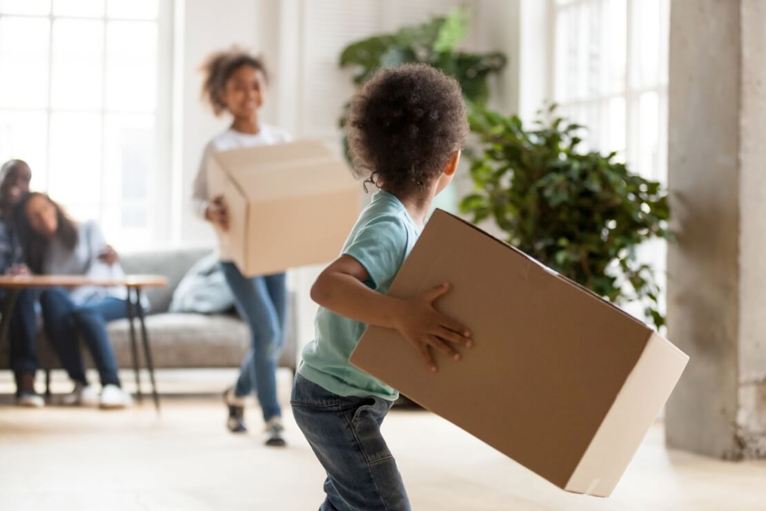 Kids Holding Moving Boxes